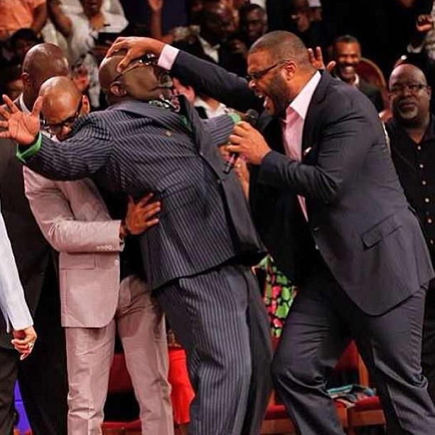 Tyler Perry lays hands on Bishop T.D Jakes and the crowd goes wild….