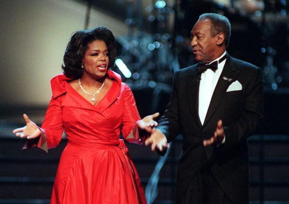 Co-hosts Oprah Winfrey and Bill Cosby joke with ea